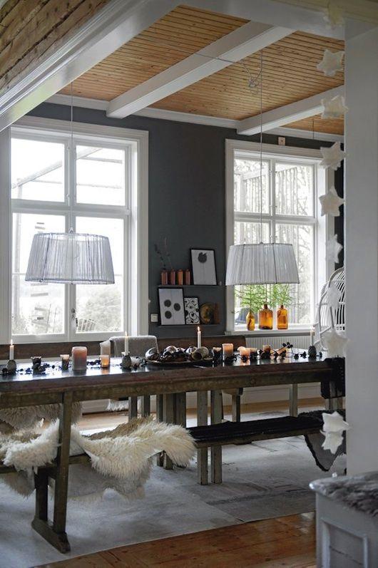 Gray, paneled ceiling, fern leaves on windowsill, warm dining room