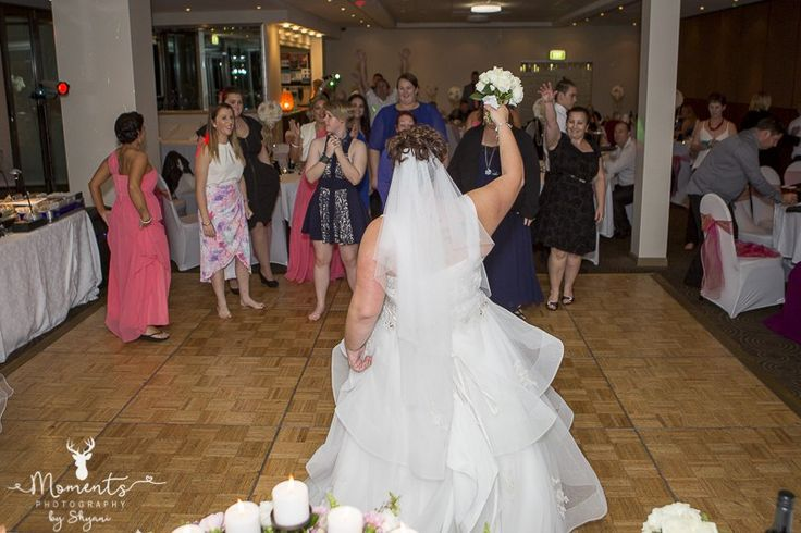 Sydney Wedding Photography. Bouquet toss. Wedding decor. Pink. Wedding reception. The Waterfront function centre - St George Motor Boat Club. www.momentsphotography.com.au