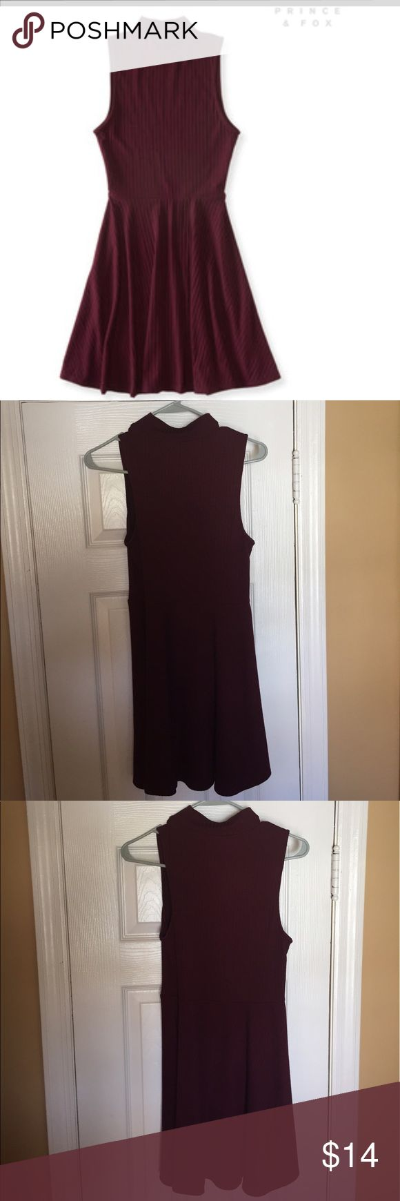 """Aeropostale- burgundy mock -neck sleeveless dress. Adorable dress, mock neck, sleeveless. Color is burgundy for fitting on top then flare bottom/skirt. Measurements : 28"""" Chest & waist at the seam, 32"""" length from top shoulder. Prince fox by Aeropostale. Model in the picture is 5'10"""". Dresses Mini"""