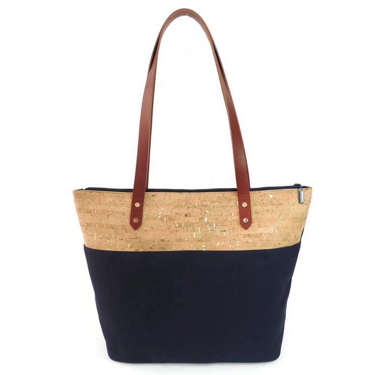 Spicer Bags - Travel Tote in Cork Dash Gold and Navy Canvas, $138.00 (http://www.spicerbags.com/travel-tote-in-cork-dash-and-navy-canvas/)
