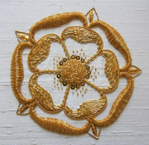 IMG_2447a  Gold work enbroidery. Beautiful. I soo a gold person more than siver.   Visit her blog for more....  http://www.theunbrokenthread.com/blog/2012/08/03/rsn-goldwork-day-6-cut-work/
