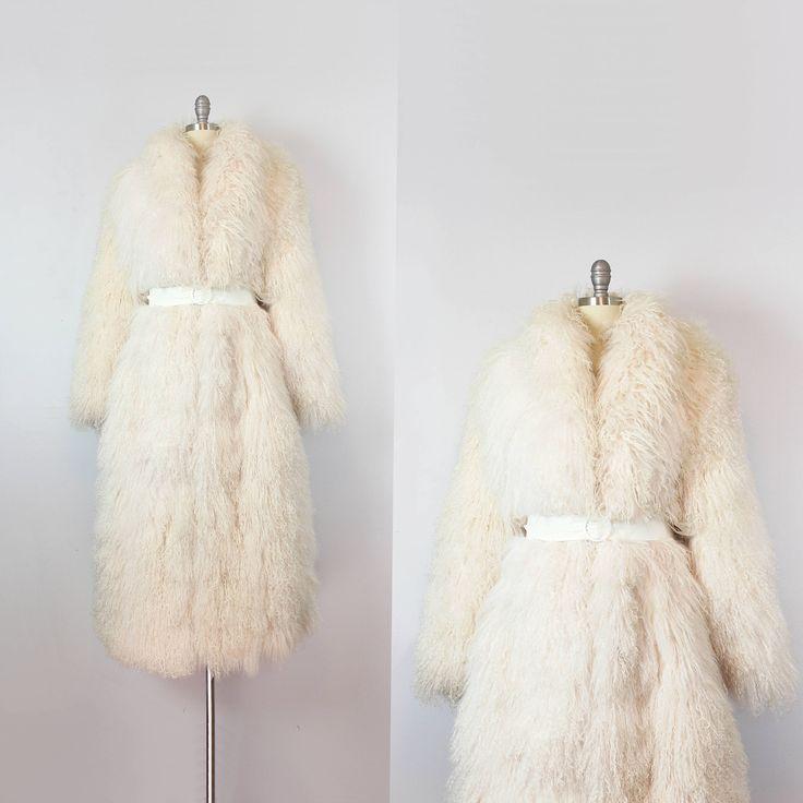 vintage 70s shag coat / 1970s shaggy fringe coat / Mongolian lamb fur coat / luxe bohemian coat / statement coat by archetypevintage on Etsy https://www.etsy.com/listing/551363918/vintage-70s-shag-coat-1970s-shaggy