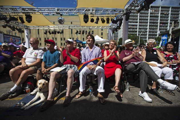 Liberal Party of Canada leader Justin Trudeau (C), Canada's first openly gay Ontario Premier Kathleen Wynne (3rd R), former Liberal Party of Canada leader Bob Rae (2nd R) and Wynne's partner Jane Rounthwaite (R) attend an outdoor church service before the gay pride parade in Toronto, June 30, 2013