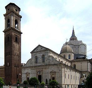 Duomo of Torino (Turin Cathedral) (foreground) is the major Roman Catholic church of Turin, Piedmont, Italy.  Dedicated to Saint John the Baptist (San Giovanni Battista), it was built during 1491-1498. The Chapel of the Holy Shroud (Cappella della Sacra Sindone), the current resting place of the Shroud of Turin, was added to the structure in 1668-1694 (background).  The belltower is to the left.