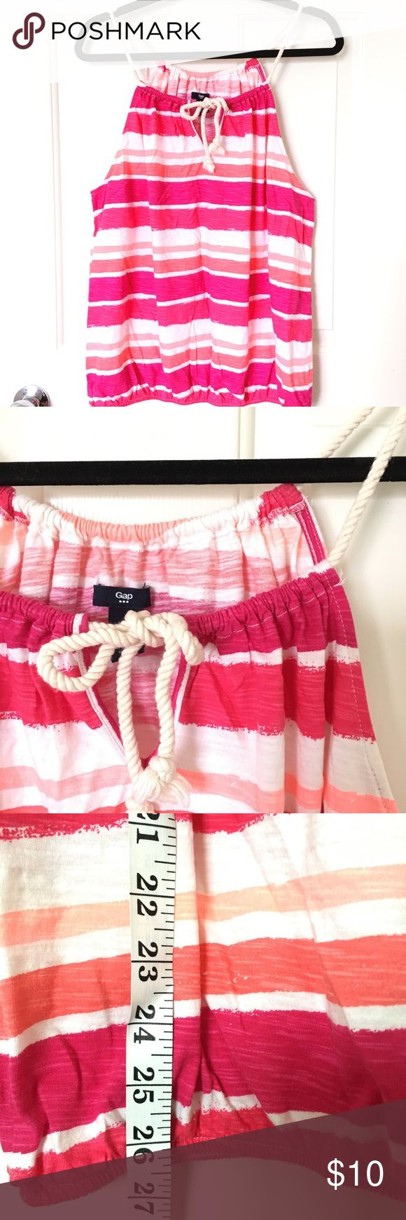 🎉 SALE Gap pink white stripe halter top rope bow This striped halter type tank top has hot pink, coral, and white stripes. It features a rope neck detail that ties in front. The bottom has elastic that creates a billowing effect. Fits large. Gap Tops Tank Tops