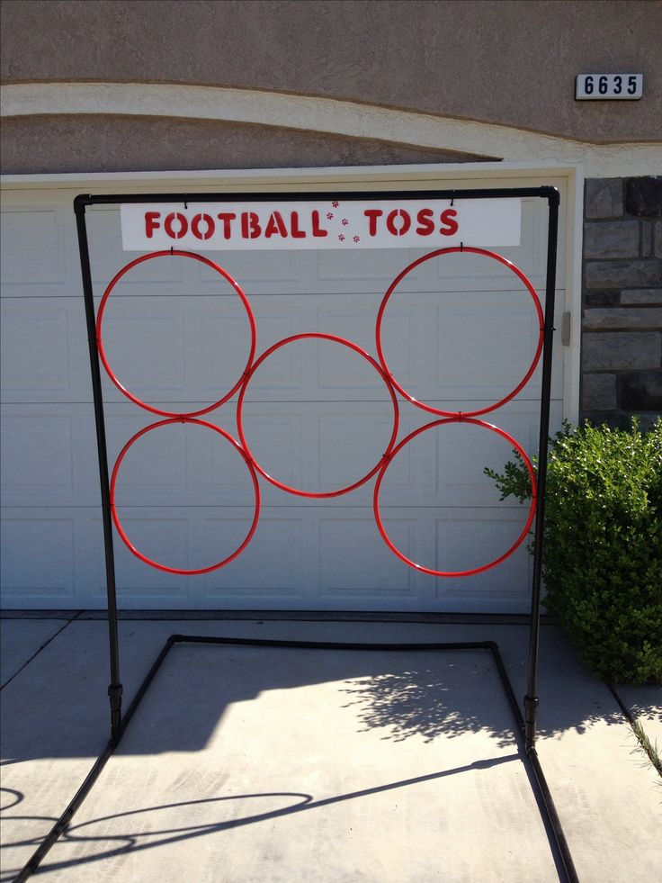 Football Toss school carnival game. Frame made out of pvc pipe and the rings are hoola hoops zip tied to frame. The kids loved it!