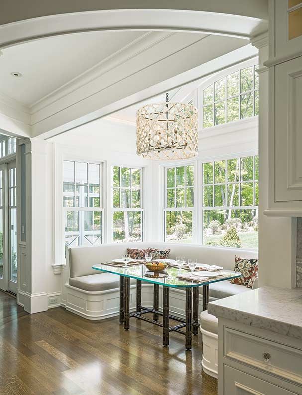 Gleysteen blends the interior and exterior through the introduction of this large breakfast nook bay. Oversized windows surround the banquette, making the dining experience feel alfresco.