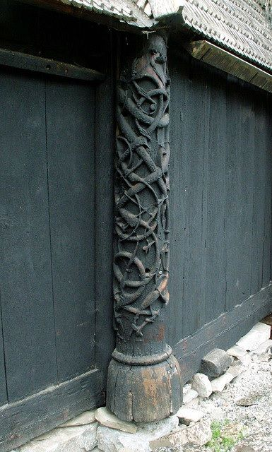 Carved pillar at historic Urnes Stave Church, Norway ...