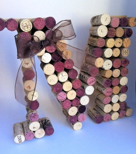 Ask the bartender to save all the wine corks from the wedding. Glue then together to make a monogram for the mantle. Awesome!!