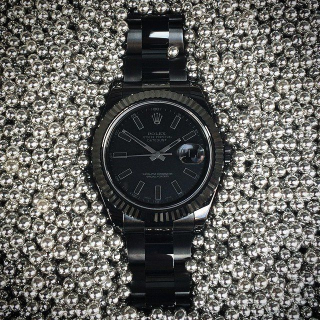 """Limited Edition Rolex Datejust II in Shadow. - Comes complete with a 24 month warranty.- Coating: Complete (DLC) Diamond-Like-Carbon Coating- Dial: Black Dial with Dark Grey Indices- Unique: Individual Numbering Laser Engraved 01/50- Movement: Automatic Movement with Date Function- Case: 41mm- Water Resistance: 100M / 330FT- Glass: Sapphire crystal- Bracelet: Rolex """"Oyster"""" Flip - Lock Bracelet Please allow 4 weeks for shipping."""