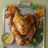Honey Roast Turkey Recipe ~ Give your Thanksgiving turkey a burst of flavor by injecting it with seasoned liquid -- we put a mixture of honey, sage, garlic, and olive oil directly into the meat before roasting it.