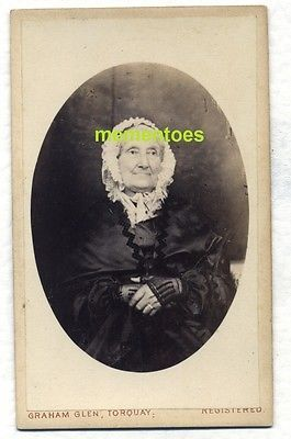 Wonderful portrait of Elderly-Woman-c1870-CDV-Torquay-Devon-Graham-Glen-Miniature-Artist. Note goves & bonnet. ~ Original, vintage, c1870, wonderful quality, carte de visite portrait photograph of an elderly lady. Photograph by Graham Glen, 1 Cary Parade, Torquay, Devon, England. It states on the rear that he did Locket Miniatures. Size of the cdv is 6cm x 10cm approx. (including the mount board).
