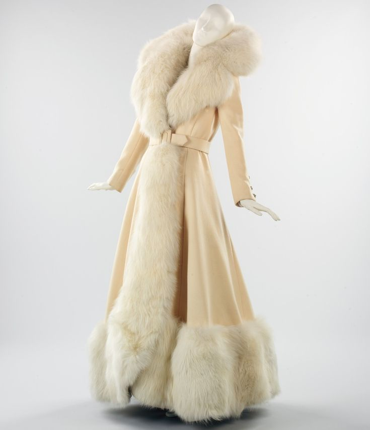 Evening Coat Shannon Rodgers 1968 This evening coat, with its sweeping proportions and generous use of white fox fur, harks back to 1930s glamour. It was created by respected American designer Shannon Rodgers. Shannon Rodgers early work was as a designer on Broadway. In the 1930s he was hired by film director Cecil B. DeMille as a studio artist. DeMilles Cleopatra is among the films Rodgers worked on. In 1946, he was hired by Jerry Silverman (1910-1984) as a designer for M…