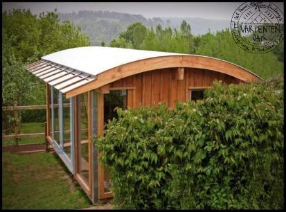 Adam's Cabin, A douglas fir curved roof room for a teenage son, office or studio by Carpenter Oak Ltd