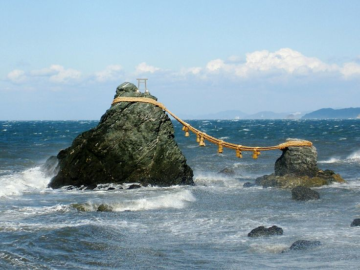 Meoto Iwa, or the Married Couple Rocks, are a couple of small rocky stacks in the sea off Futami, Mie, Japan.