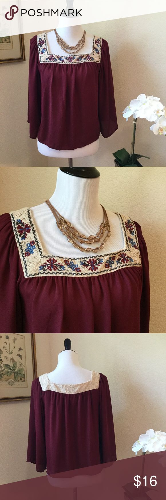 FLYING TOMATO Lace & Embroidery Peasant Top Beautiful flowing festival blouse in a rich burgundy color accented with ivory lace and floral embroidery. This top has a square neckline, wide sleeves and a flowing shorter length body. Wear with to a summer concert with denim shorts. In excellent condition. Flying Tomato Tops Blouses