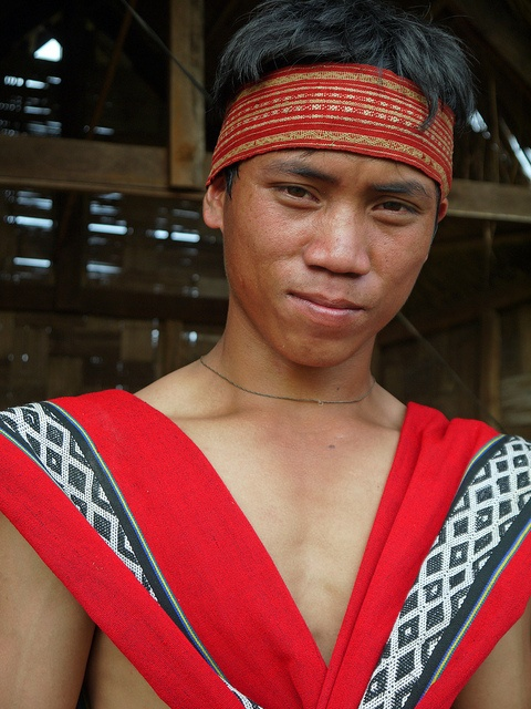 A Katu boy wearing traditional clothes, near Sekong, Laos.