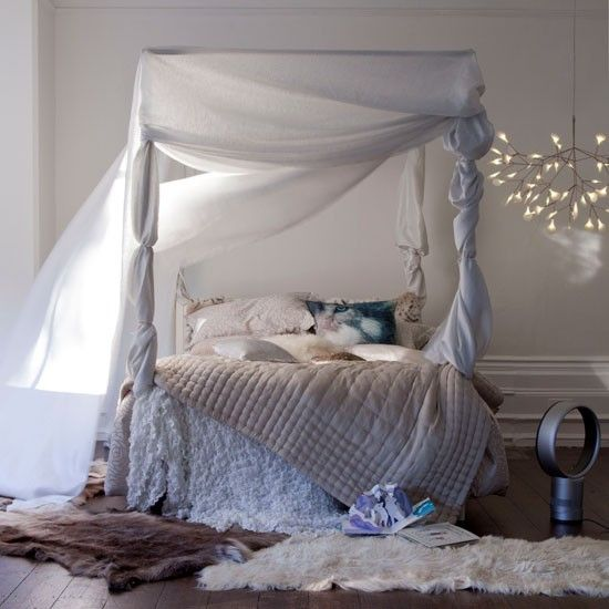 Serene bedroom with four-poster bed and white drapes Sleeping Beauty, eat your heart out! A four-poster bed, white drapery AND pretty fairy lights: this bedroom design idea is so romantic we're practically swooning just looking at it.