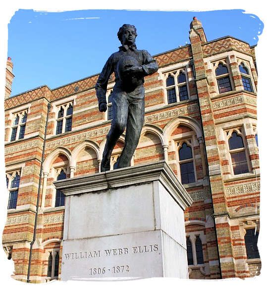 Statue of William Webb Ellis, behind him Rugby School located in the town of Rugby, Warwickshire, the school he used tot go to.