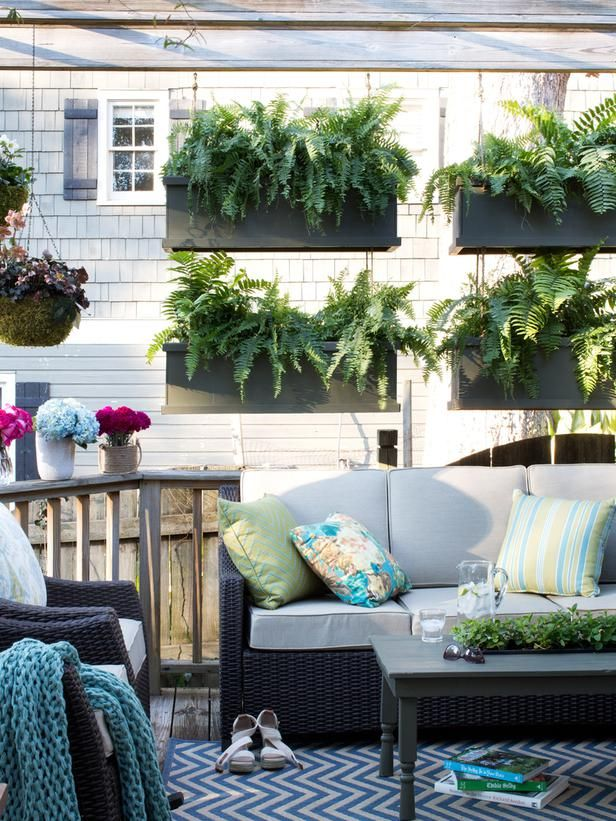 Create Privacy - Sprucing Up an Outdoor Living Space for Spring on HGTV...hanging flower boxes