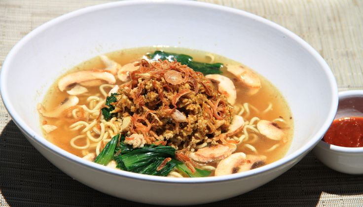Mie Ayam Yellow wheat noodles with chicken, mushrooms in soup with fragrant herbs  Shallots and green onions