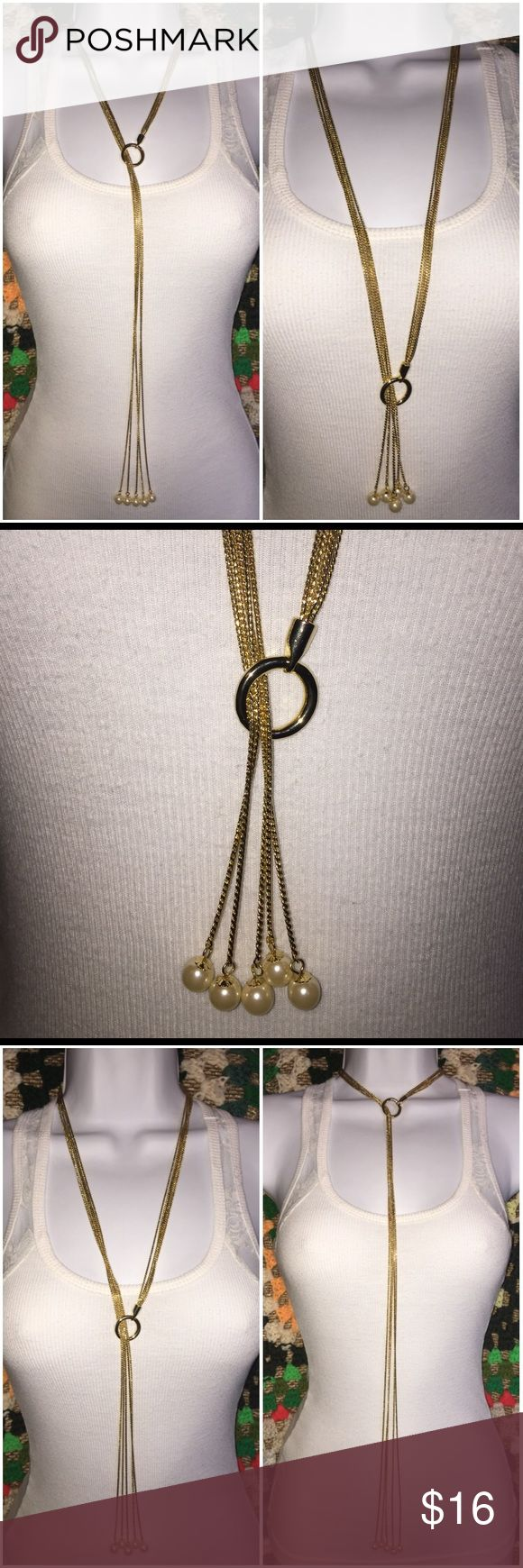 "R.J. Graziano Pearl Gold Tassel Lariat Necklace R.J. Graziano Faux Pearl Gold Tone Lariat Tassel Necklace. A Gorgeous timeless design captured in extraordinary detail. A Finely crafted creation from hand-fashioned faux Pearls & gold tone multi dangle strands that leads to small faux Pearl ball ends. Gold tone O-ring loop on one end so you can create many ways to wear this lariat (some ways shown in pictures), very versatile! Compliments any wardrobe. Measurements: 33 1/4"" Long. Brand new in…"