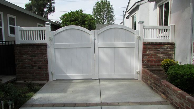 driveway makeover with double vinyl gates and wall toppers. Completely custom to the homeowners needs