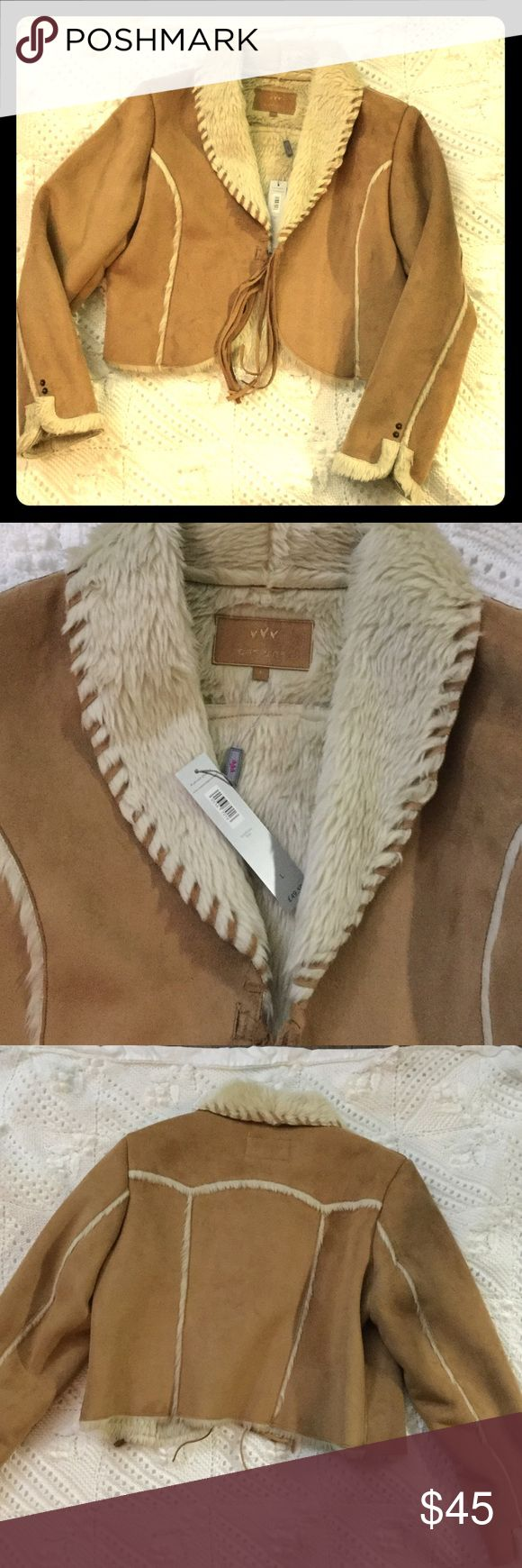 NWT Tan faux suede and fur jacket tassel closure NWT from Marks & Spencer in England. Faux suede and fur jacket. Beautiful tan color with beige fur trim down sleeves and on back. Inside and sleeves are completely lined with fur. Has suede stitching around collar and tassel fringe closure. Size large. Jackets & Coats