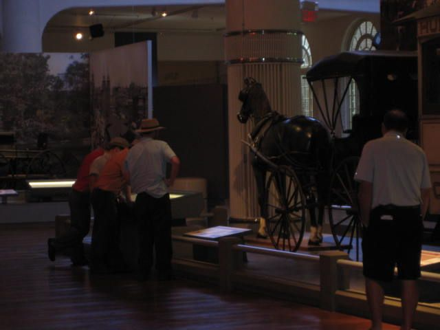Amish at the Ford Museum looking at a buggy *smh and laughing*