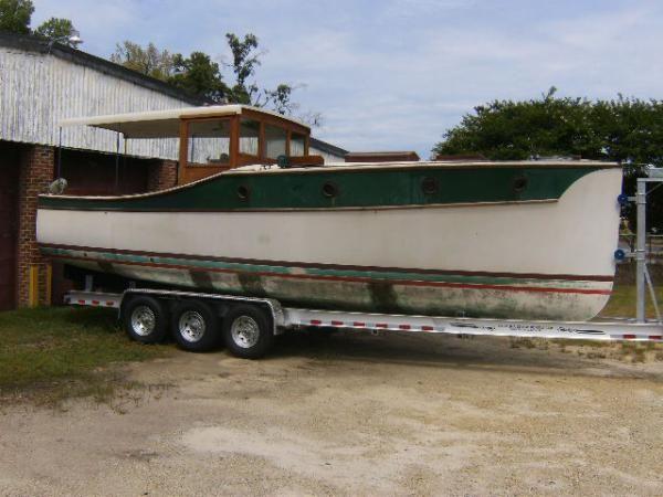 Carolina Classic Boats and Cars : Classic Wooden Boats and Automobiles including Chris Craft, Gar Wood, Riva, Hacker Craft, Trumpy, Porsche, Ferrari, Jaguar, Mercedes, Maserati, and other classics.
