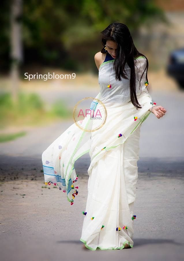 Beautiful white saree, with sprinkling of colored tassels, via @sunjayjk