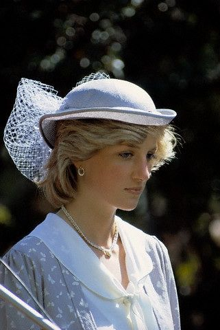 Diana was photographed at an Australian football match on April 8, 1983. She wore the diamond and pearl necklace with a heart that Charles gave her to celebrate the birth of William. Her earrings were gold and diamond circles.