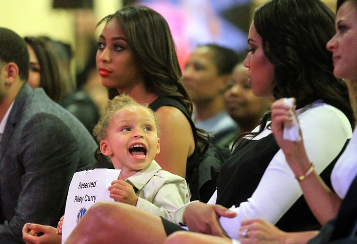 Stephen Curry's daughter, Riley Curry, looks to her mother, Ayesha Alexander, right, during the press conference announcing Stephen Curry as the 2014-15 Kia NBA Most Valuable Player during a press conference at the Oakland Convention Center in Oakland, Calif., on Monday, May 4, 2015.  (Laura A. Oda/Bay Area News Group)