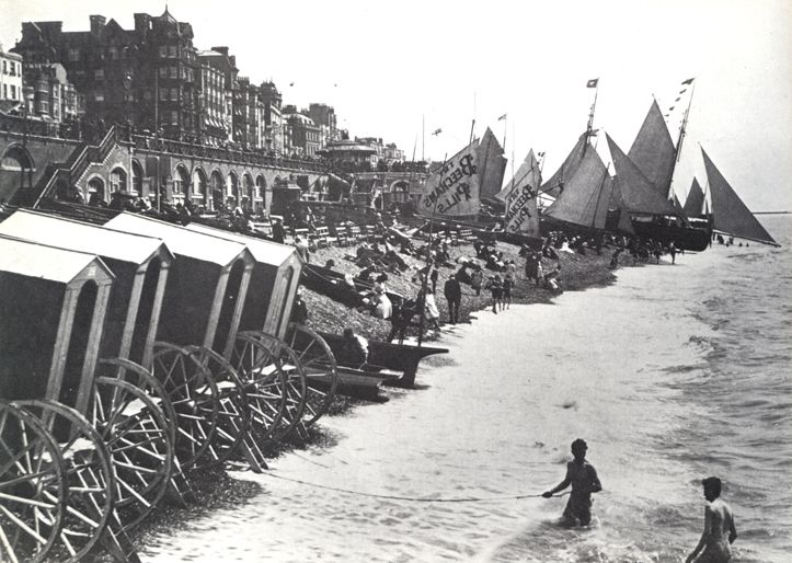 Men's bathing machines on a stretch of Brighton beach - Brighton Swimming Club has quite a history