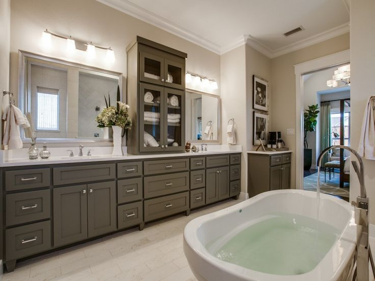 Pics Of Matching vanities with glass fronted cabinets define this spacious spa like Owner us Bath