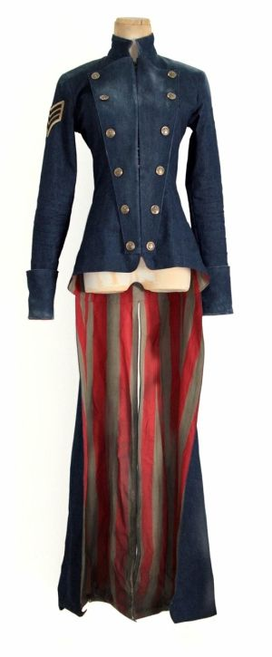 This fantastic outfit has a late 1800s Victorian military cut, and a clean cut style evoking the American flag, while showing off a great figure.   This would be a great base for a steampunk outfit, but I'd love to see the creator's use for it.