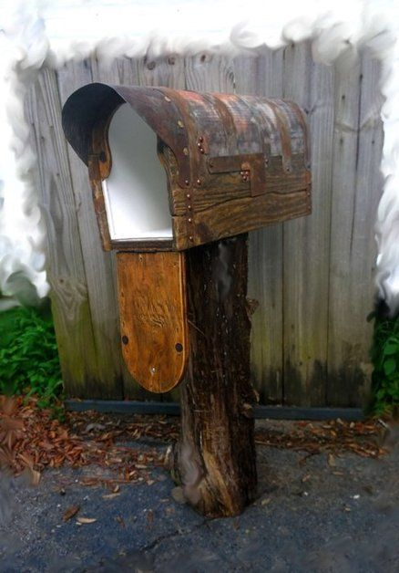 Rustic mailbox with cedar door. could use old tin for that roof