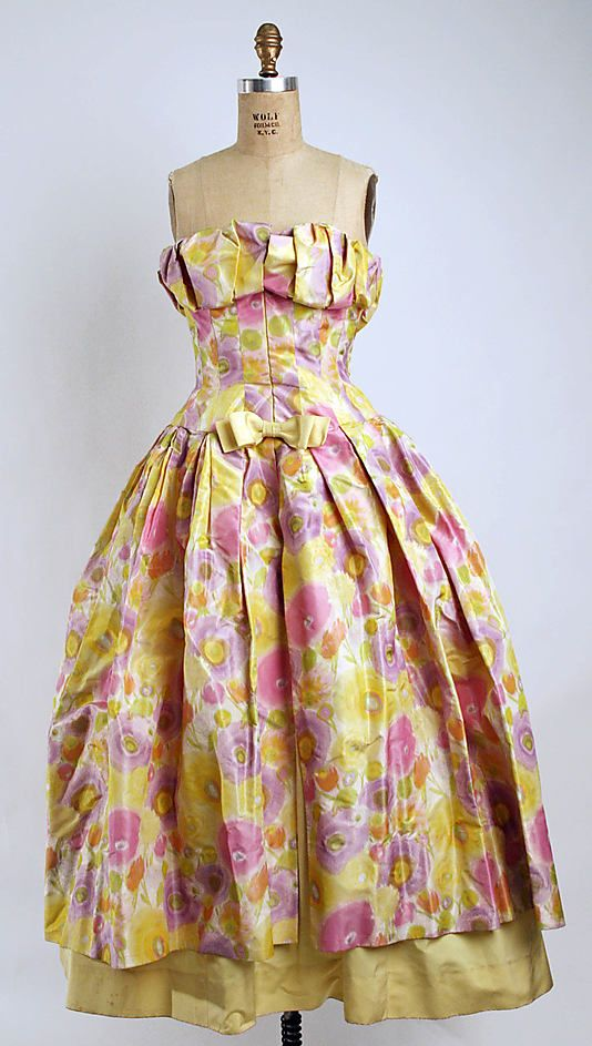 Balmain Haute Couture evening dress from 1960. Strapless design with decorated bow in decollete and bodice with puff full skirt made from flower floral patterned printed silk.   Pierre Balmain House of Balmain.