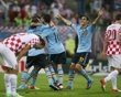 Spain's Jesus Navas (obscured) celebrates with his team mates after scoring a goal against Croatia during their Group C Euro 2012 soccer match at the PGE Arena in Gdansk, June 18, 2012.