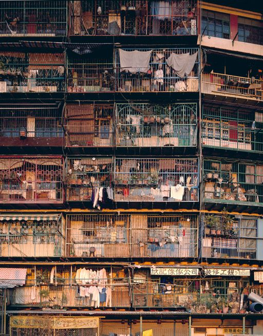 One of the great contributions to the richness of Hong Kong's urban scene were without doubt the caged balconies that lined the elevations not only of the Walled City, but also of many of the city's other older tenement buildings. Sadly now but a distant memory, since they were classified as illegal structures in the late 1990s and torn down, these practical and otherwise very necessary additions to life in a tiny apartment were a source of constant delight.
