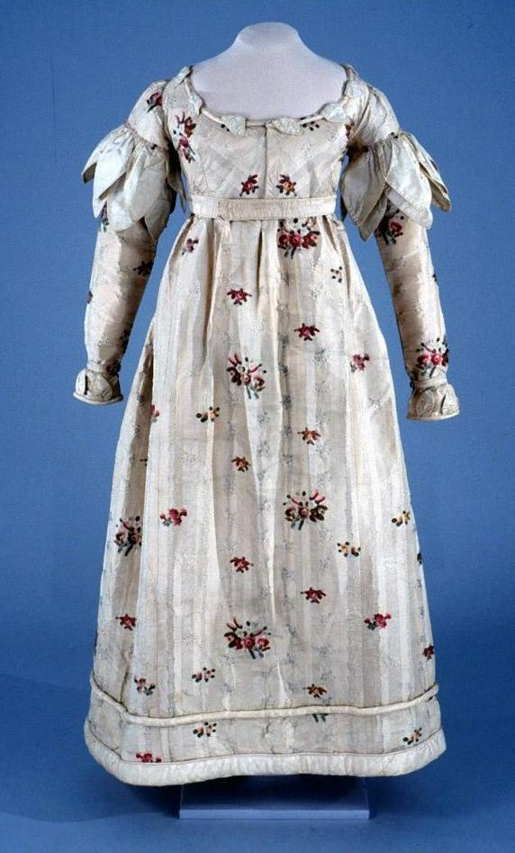 Gown: ca. 1820's, ca. 1770-1780 (textile), European or American,  silk woven with striped and floral self pattern in warp and weft floats and brocaded with multicolor floral clusters, trimmed with corded taffeta, bodice lined in cotton, padded hem. [Search for Acc. No. 1999-248]