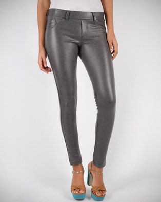 Show a little attitude in these Metal Leggings by Linx. Streamlined from hip to hem with a sleek, high shine finish, these leggings are made for the woman who loves to stand out from the crowd. Team it up with a navy, crocheted midriff and a chunky statement necklace. Finish your outfit with black sandals and a dark red pout and you\'ll rock a glammed up, 80s-inspired look.