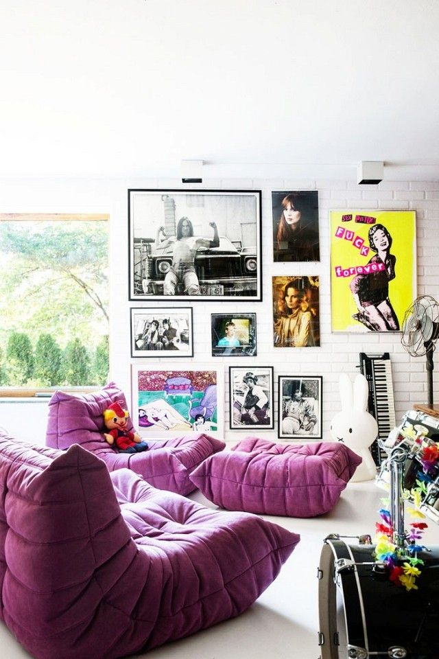 Eclectic bohemian inspired living room with a neon pop art gallery wall