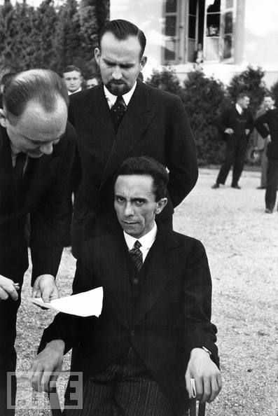 """1933, Nazi Propaganda Minister Joseph Goebbels (seated). Alfred Eisenstaedt (the photographer) recalled that Goebbels smiled at him until he learned that Eisenstaedt was Jewish -- a moment Eisenstaedt captured in this photo. Suddenly, """"he looked at me with hateful eyes and waited for me to wither,"""" the photographer recalled. """"But I didn't wither."""" Not only didn't he wither, but he managed to take perhaps the most chilling portrait of pure evil. CREEPY."""