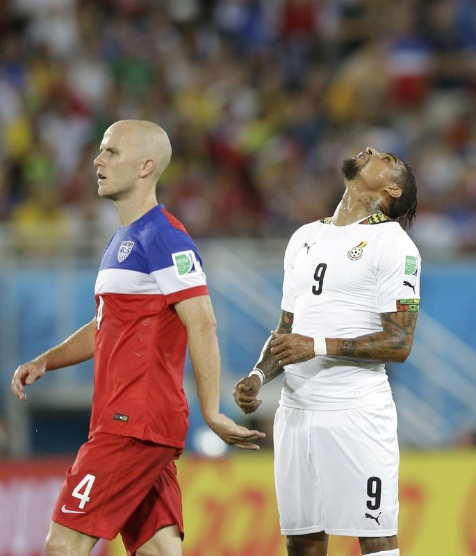 Ghana's Kevin-Prince Boateng, right, reacts after missing a chance on goal as United States' Michael Bradley looks on during the group G Wor...