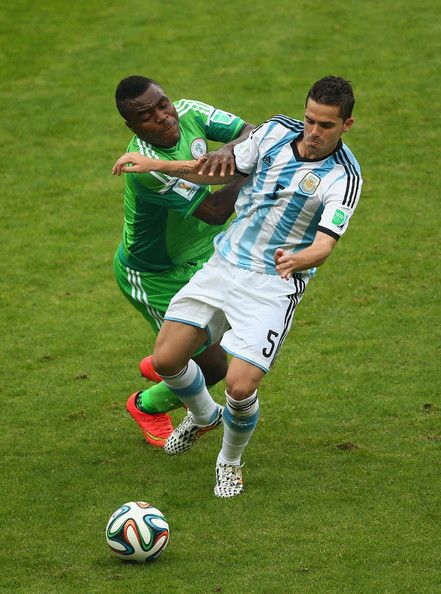 Emmanuel Emenike of Nigeria challenges Fernando Gago of Argentina during the 2014 FIFA World Cup Brazil Group F match between Nigeria and Ar...