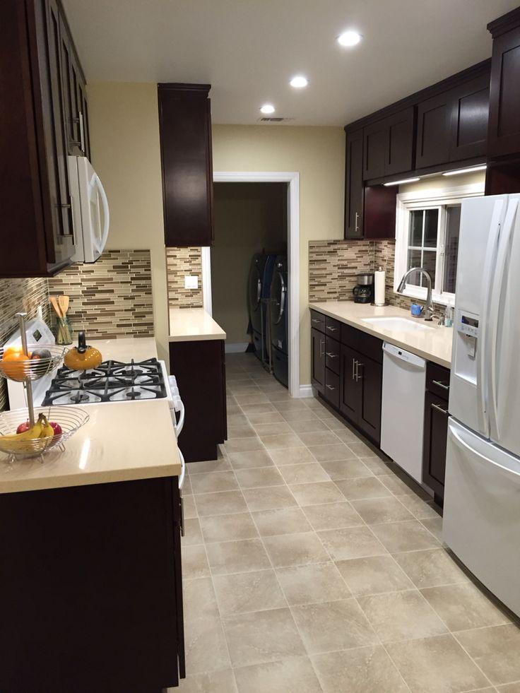 Espresso Kitchen Cabinets with White Appliances.