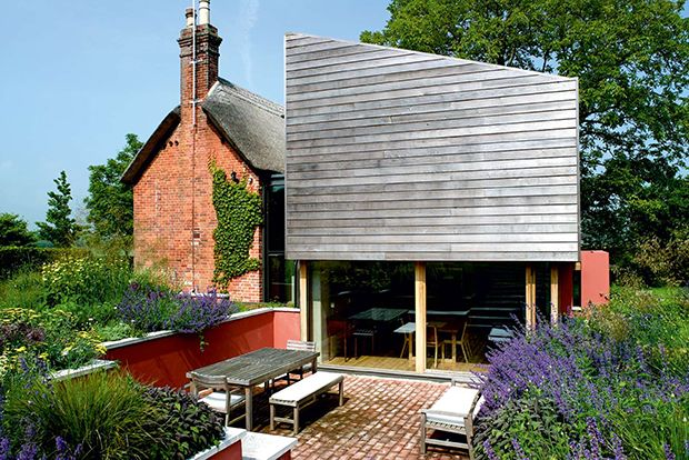 Contemporary extension to thatched cottage, Wiltshire, England…