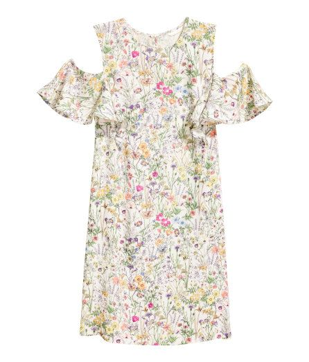 Check this out! Short dress in soft, woven viscose fabric with a printed pattern. Opening at back of neck with button and short, ruffled sleeves with cut-out sections at shoulders. Unlined. - Visit hm.com to see more.