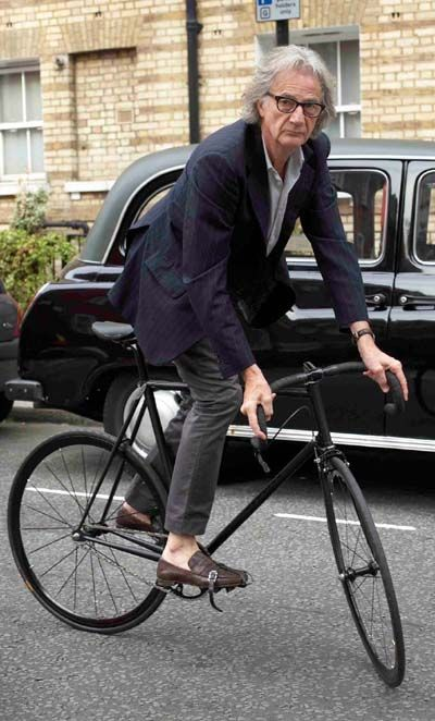 Lee Renee Jewellery* Sir Paul Smith - world renowned fashion designer who undertakes other design projects, including one with Mercian Cycles at Derby, seen here track standing on his 'stealth' Mercian track machine finished in matt black and devoid of any transfers or badges apart from 'Paul Smith' engraved topeyes. (Image Horst Friedrichs)